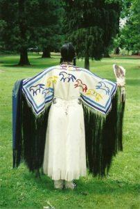 Shauna Zeck in traditional native American powwow regalia